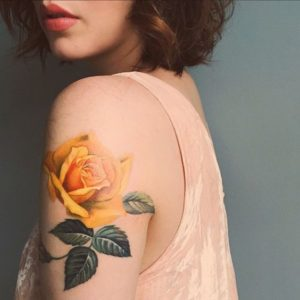 yellow rose tattoo shoulder meaning