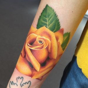 yellow rose tattoo with meaning