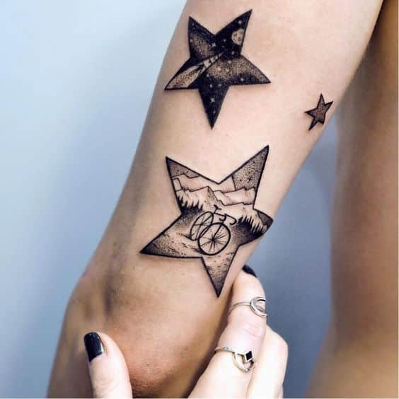 Star tattoo with landscapes inside