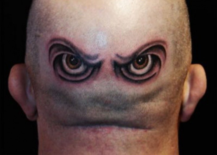 Funny tattoos: eyes in the neck