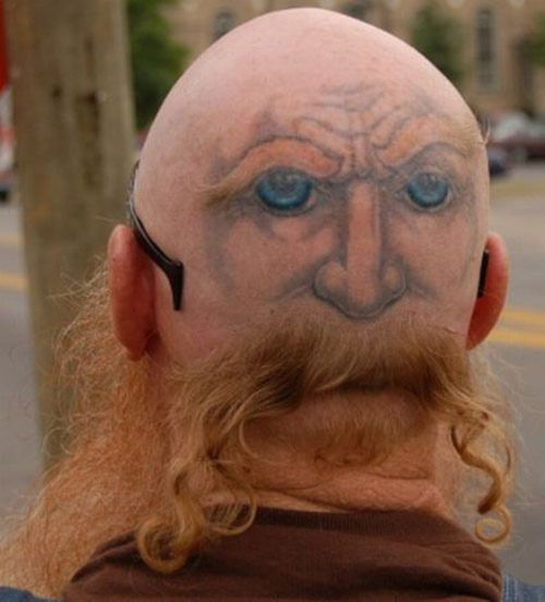 Funny tattoos: face on the back of the head