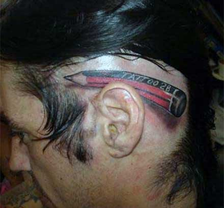 Funny tattoos: pencil in the ear