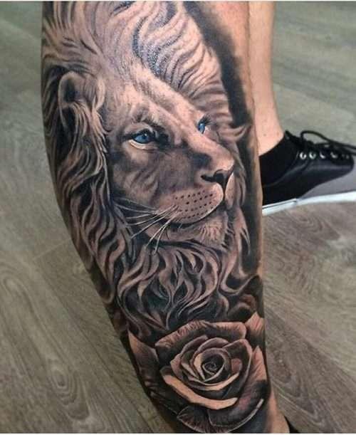 Tatuaje de león en la pierna